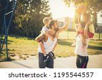 fight for the ball. family... | Shutterstock . vector #1195544557