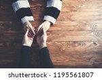 man and a woman holding hands... | Shutterstock . vector #1195561807