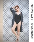 attractive asian woman wearing... | Shutterstock . vector #1195563007