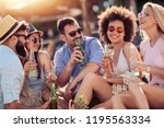 cheerful group of friends... | Shutterstock . vector #1195563334