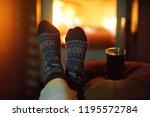 woman wearing woollen socks... | Shutterstock . vector #1195572784