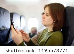 young woman traveling by an...   Shutterstock . vector #1195573771