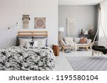 hanging chair above carpet in...   Shutterstock . vector #1195580104