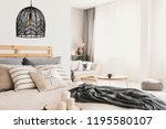candles next to bed with... | Shutterstock . vector #1195580107