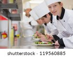 happy chef looking up from... | Shutterstock . vector #119560885