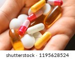 many different pills in female... | Shutterstock . vector #1195628524