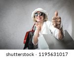 senior woman with shopping bags ... | Shutterstock . vector #1195631017