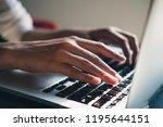 female freelancer's hands using ... | Shutterstock . vector #1195644151