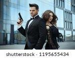 an elegant man with pistols in... | Shutterstock . vector #1195655434