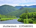 endless green mountains and...   Shutterstock . vector #1195680301