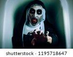 closeup of a frightening evil... | Shutterstock . vector #1195718647