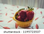 strawberries on a vintage... | Shutterstock . vector #1195723537