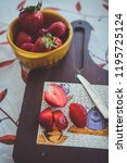 strawberries on a vintage... | Shutterstock . vector #1195725124