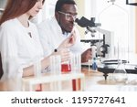 scientists work closely with... | Shutterstock . vector #1195727641