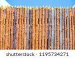 Small photo of The fence is made of uncouth logs.