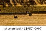 aerial view. combine harvests... | Shutterstock . vector #1195740997