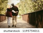 rear view of elderly man and... | Shutterstock . vector #1195754011