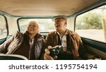 cheerful old couple sitting on... | Shutterstock . vector #1195754194