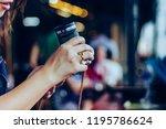 young woman prepares a camera... | Shutterstock . vector #1195786624