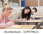 Students Taking An Exam In Exa...