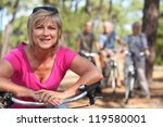 two middle aged couple on bike... | Shutterstock . vector #119580001