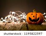 halloween pumpkin and lighting... | Shutterstock . vector #1195822597