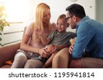 cheerful family mother father... | Shutterstock . vector #1195941814