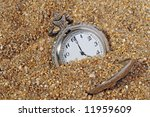 Small photo of vintage pocket watch in the sand. time concept