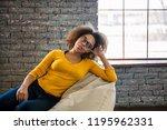 leisure. afro american girl in... | Shutterstock . vector #1195962331