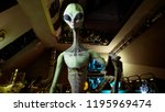 alien presses the keys on sci... | Shutterstock . vector #1195969474