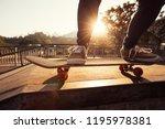 skateboarder skateboarding at... | Shutterstock . vector #1195978381