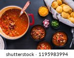 Stock photo turkey chili garnished with fresh radishes green onions and cheddar cheese 1195983994