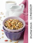 A bowl of homemade granola with goji berries on the table - stock photo