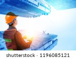 engineer with safety helmet and ... | Shutterstock . vector #1196085121