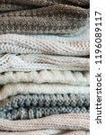 a stack of textured knitted... | Shutterstock . vector #1196089117