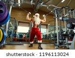santa claus bodybuilder... | Shutterstock . vector #1196113024