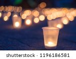 a group of candles burning in... | Shutterstock . vector #1196186581