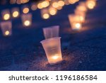 a group of candles burning in... | Shutterstock . vector #1196186584