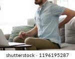 close up millennial man sitting ... | Shutterstock . vector #1196195287