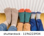 young family's feet warming... | Shutterstock . vector #1196223934