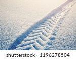 tracktor tires on winter road... | Shutterstock . vector #1196278504