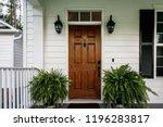 brown wood front door of a... | Shutterstock . vector #1196283817