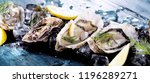 fresh opened oyster with sliced ... | Shutterstock . vector #1196289271