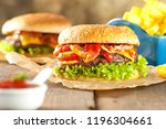 close up of home made burgers... | Shutterstock . vector #1196304661