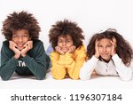 happy smiling three afro... | Shutterstock . vector #1196307184