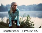 female jogger listen to music... | Shutterstock . vector #1196354527