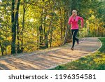 young woman running in park... | Shutterstock . vector #1196354581