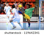 Small photo of BANGKOK,THAILAND-NOV 09:James Egeta of Solomon Islands (green) for the ball during the FIFA Futsal World Cup between Solomon Islands and Guatemala at Indoor Stadium Huamark on Nov9,2012 in,Thailand.