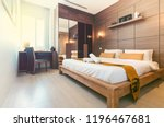 Stock photo real estate luxury interior design in bedroom of pool villa with cozy king bed high raised ceiling 1196467681