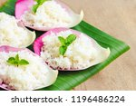 cooked rice on pink lotus petal ... | Shutterstock . vector #1196486224